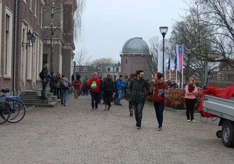 People arrived early to meet a cold grey sky.