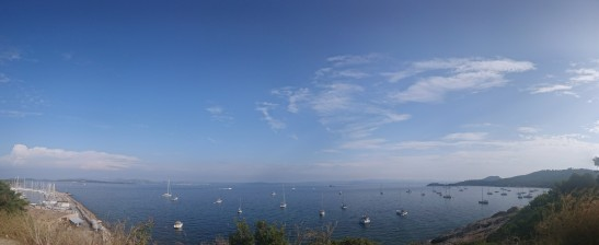 Lines of ships under clear blue sky